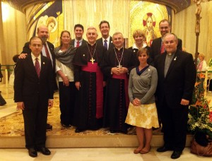 CHI Leadership Team with Archbishop Castoro in Padre Pio's Crypt in San Giovanni Rotondo, Italy